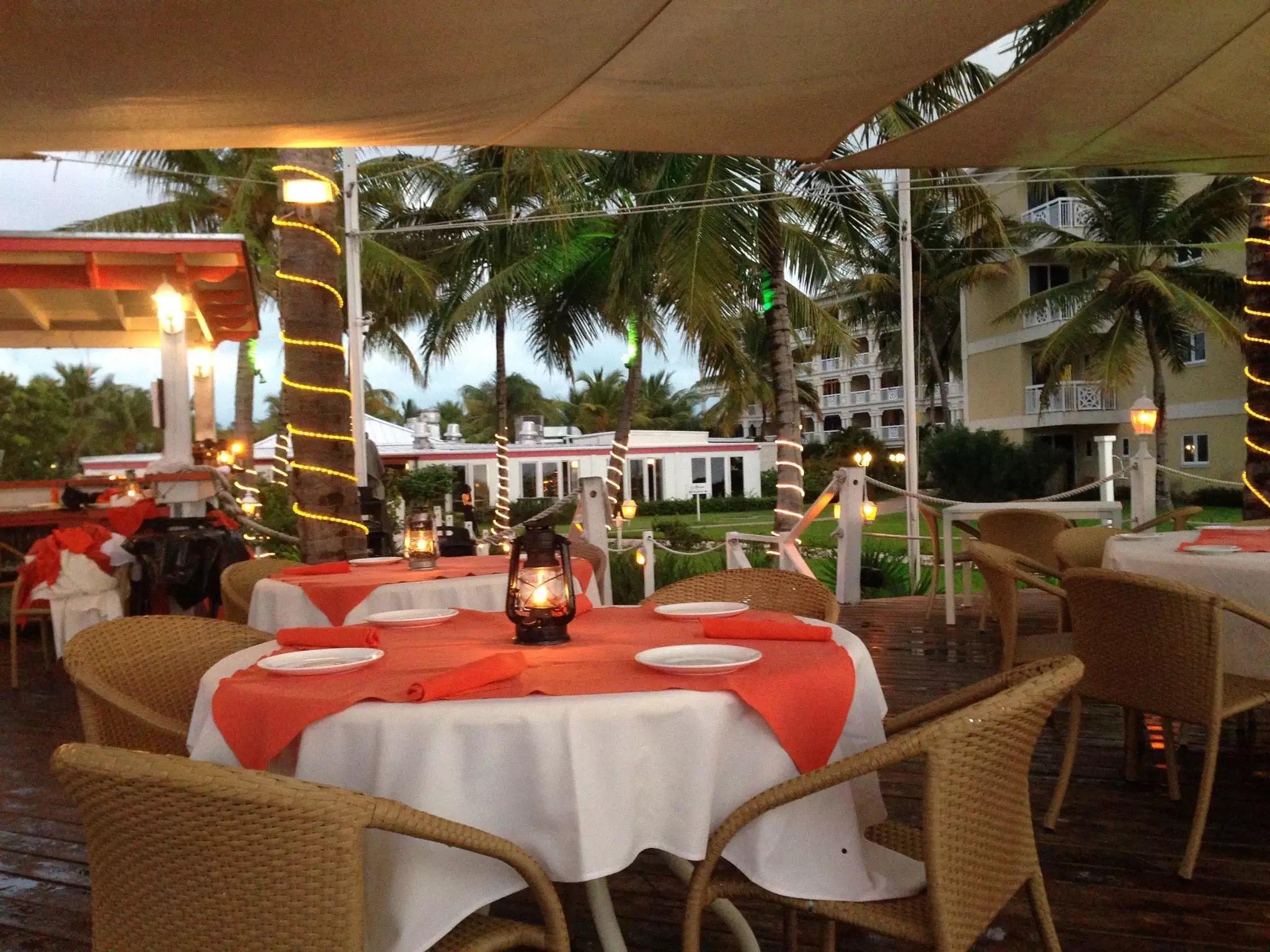 Tented patio seating at Mango Reef Restaurant