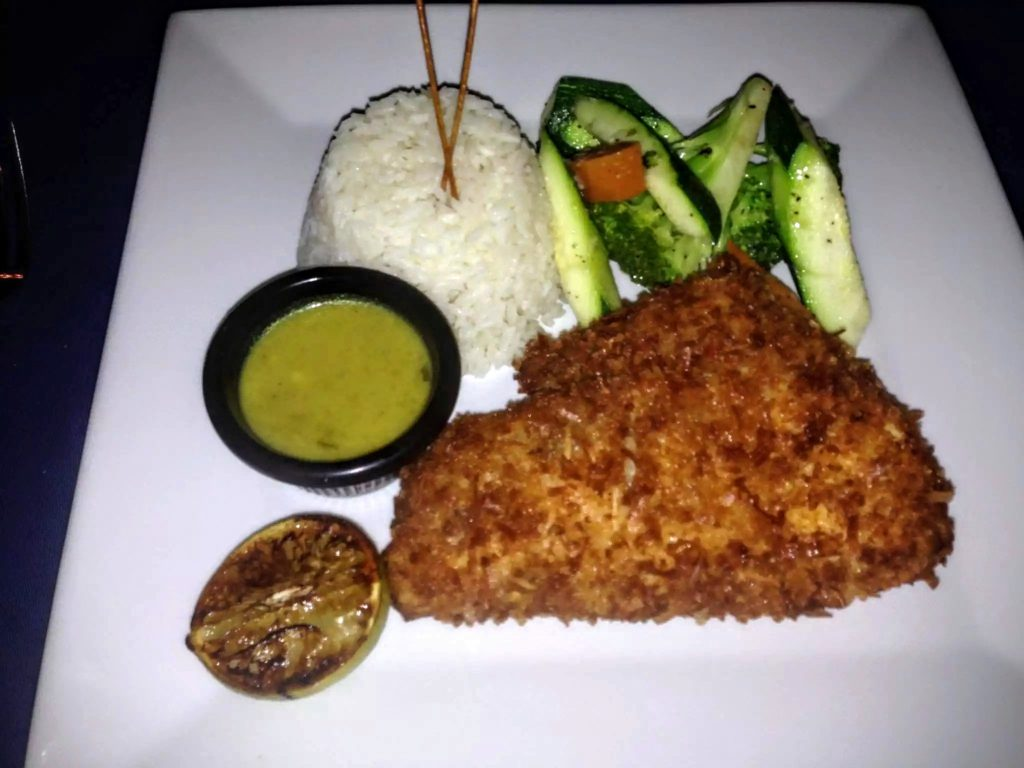 Coconut Crusted Grouper - Caicos Grouper House Dipped Coconut, Basmati Rice, Sauteed Seasonal Vegetables, Homemade Coconut Nectar