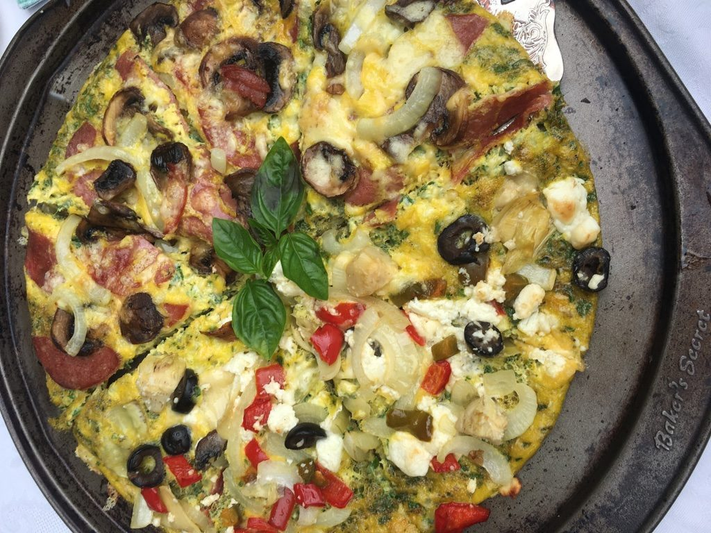 Breakfast Pizza - Salami, red pepper, goat cheese, olives, mushrooms, cheese, egg and onion