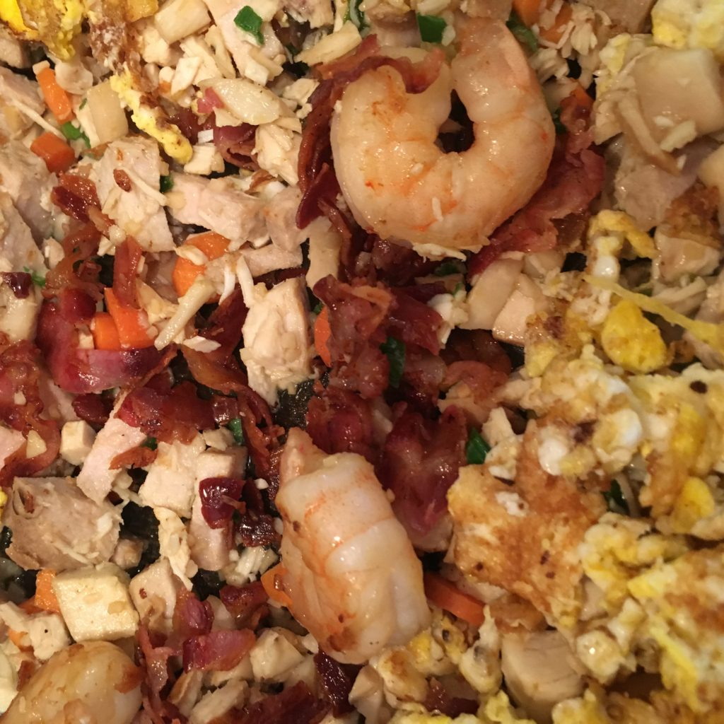 Crumbled Pancetta, Shrimp, egg, Chicken, Pork, Mushrooms, Carrots and Garlic ready to mix