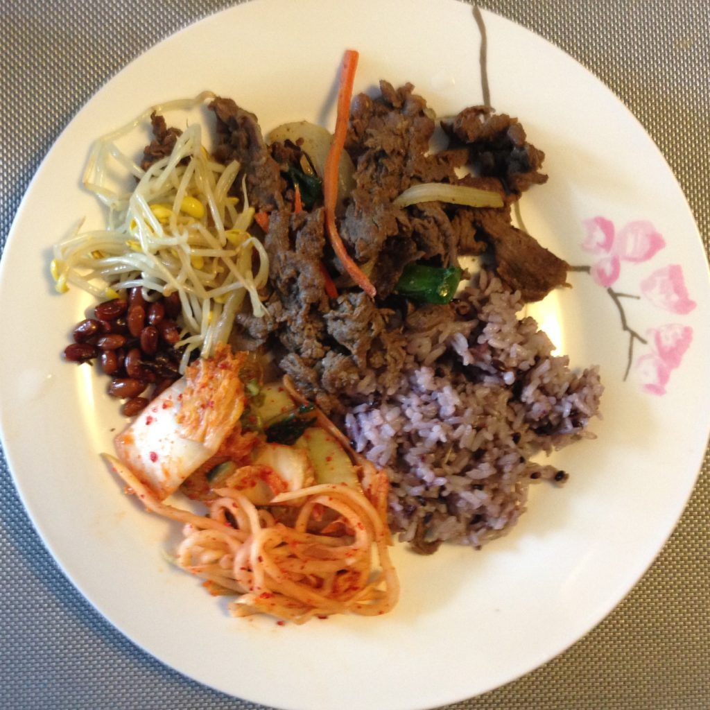 Bulgogi, purple rice, Kimchi and side dishes from Buk Chang Dong Soon Tofu