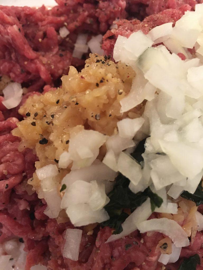 Meatball ingredients - minced beef, egg, minced garlic, basil, oregano, onion, pepper and salt