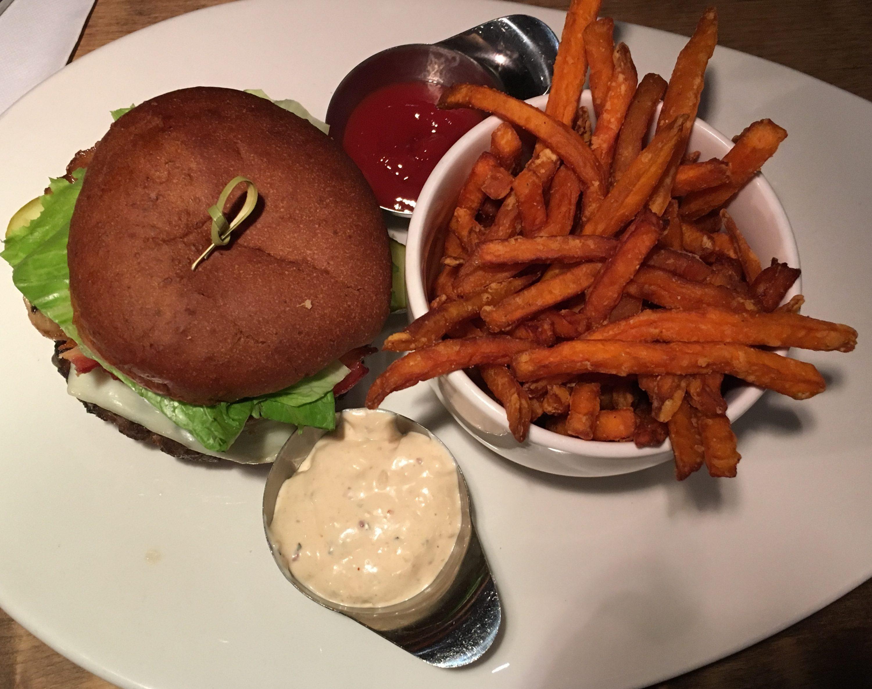 Loaded Backyard Burger with aged white cheddar, mozzarella, sautéed mushrooms, bacon & barbecue sauce (Gluten free bun optional)