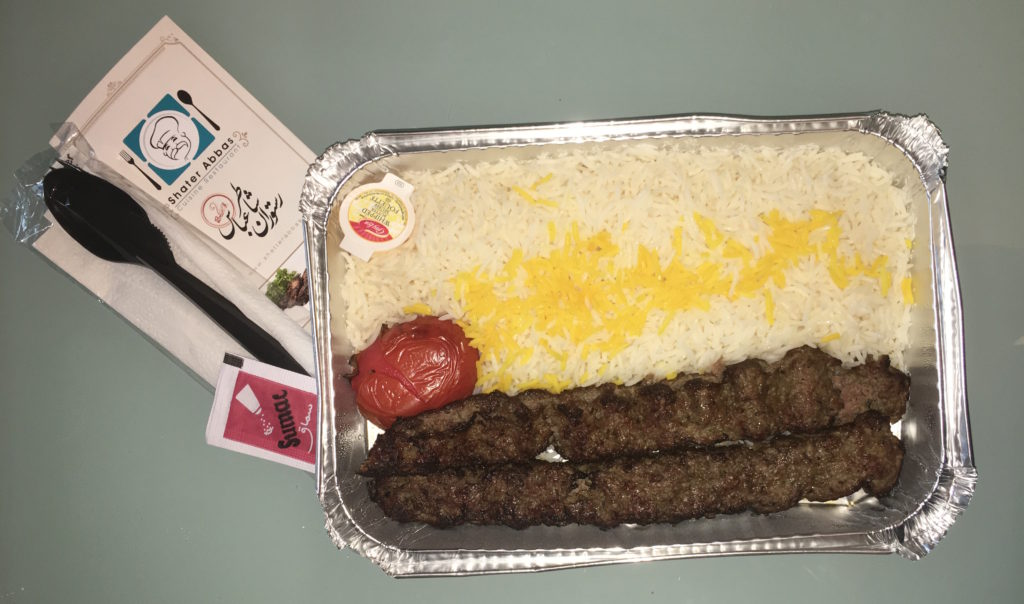 Koobideh Kebab - Two skewers of chef's lamb and beef special ground mix, basmati rice and grilled tomato