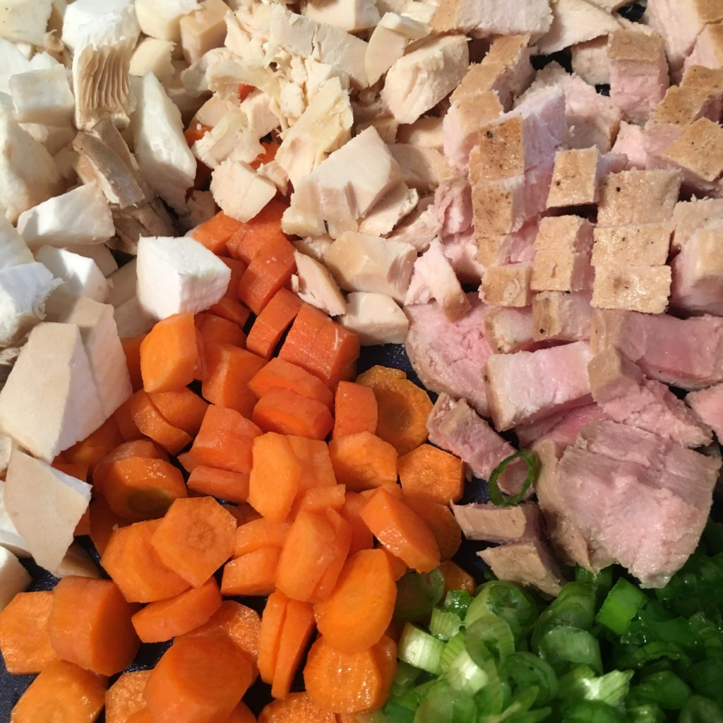 Chopped up vegetables - Carrots, Mushrooms, Green Onion, Chicken Breast and Pork Chop