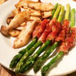 Pancetta wrapped asparagus with garlic butter King Oyster mushrooms